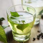 How might green tea help prevent cancer